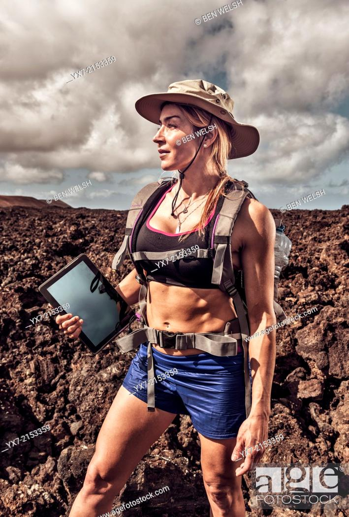 Stock Photo: Woman on a adventure holiday. Timanfaya National Park, Lanzarote, Canary Islands, Spain.