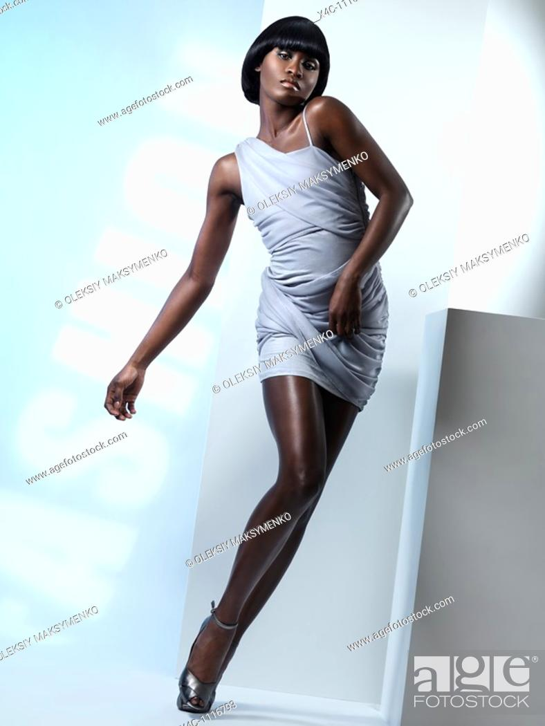 Stock Photo: Dynamic high fashion photo of a young woman in studio settings.