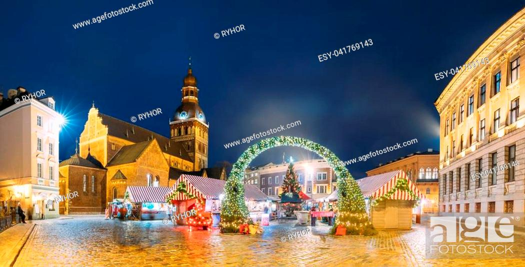 Photo de stock: Riga, Latvia. Panorama Of Xmas Market On Dome Square With Riga Dome Cathedral. Christmas Tree And Trading Houses. Famous Landmark At Winter Evening Night In.