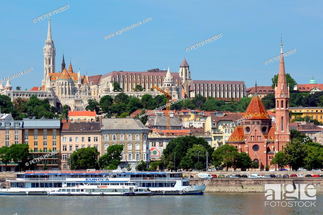 Stock Photo: View across the river Danube to the historic buildings in Buda with Matyas church, Fishermen's Bastion and Calvin's church in Budapest - Hungary.