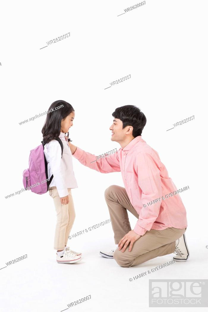 Imagen: Loving father and daughter with school bag.