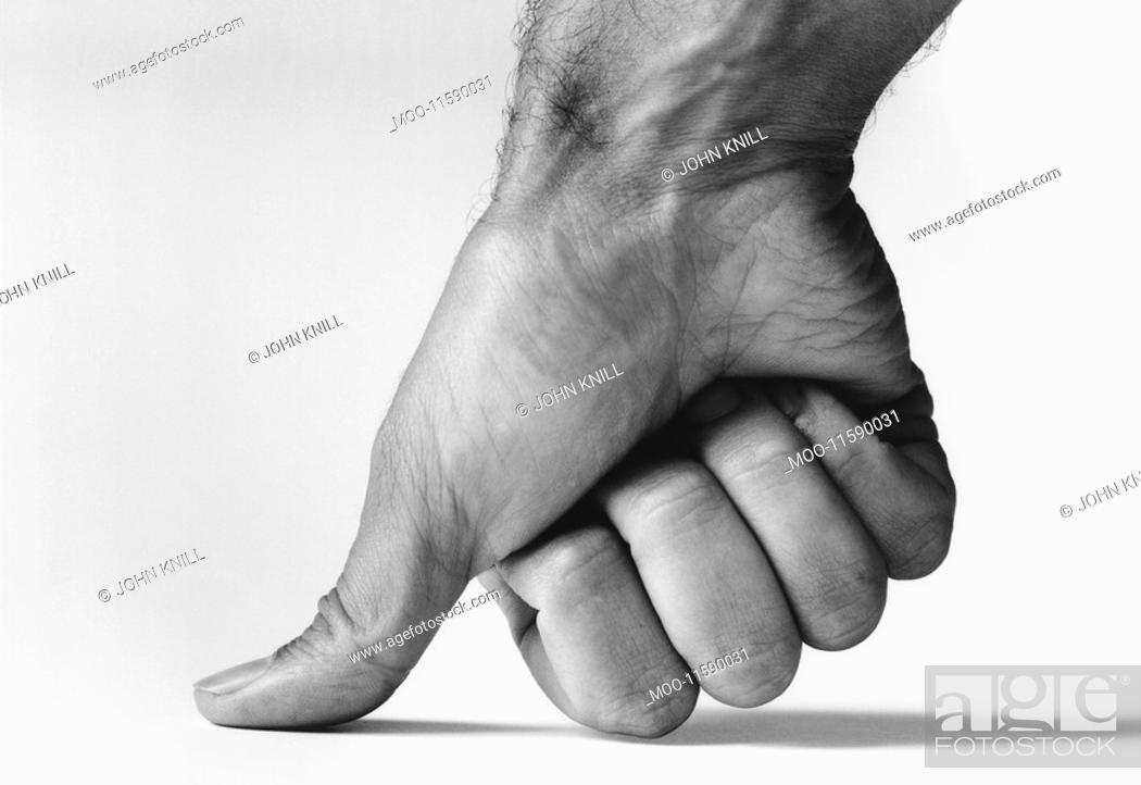 Stock Photo: Thumb pressing down b&w close-up.