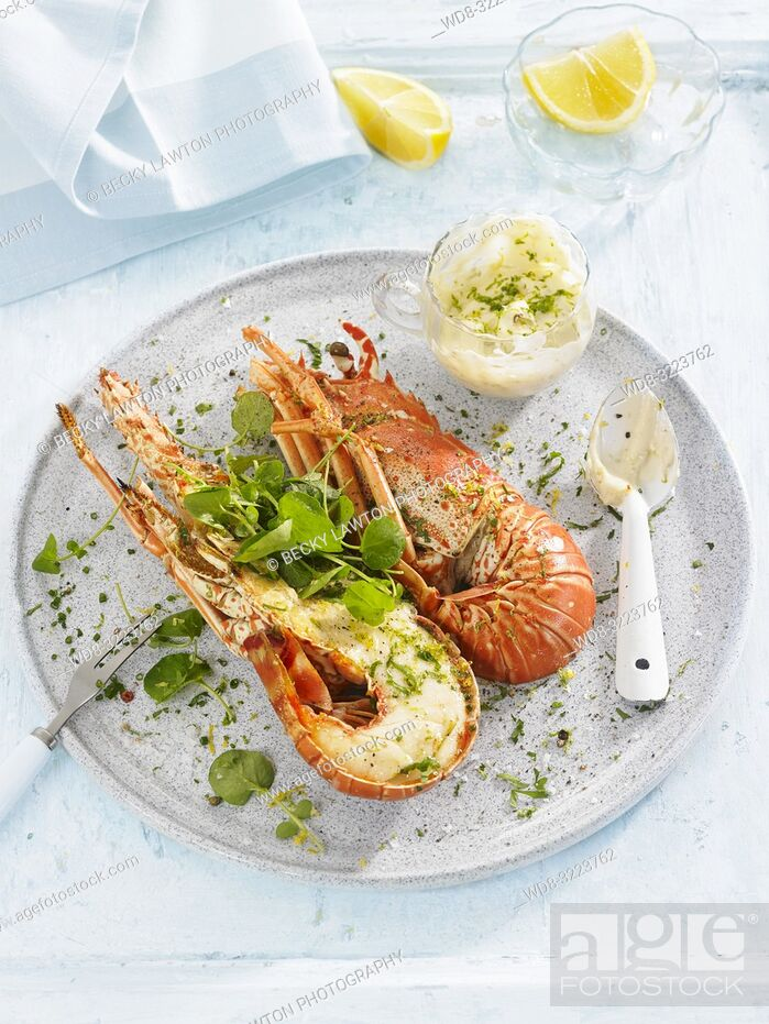 Stock Photo: langostas con bote de salsa aioli / lobsters with aioli sauce.