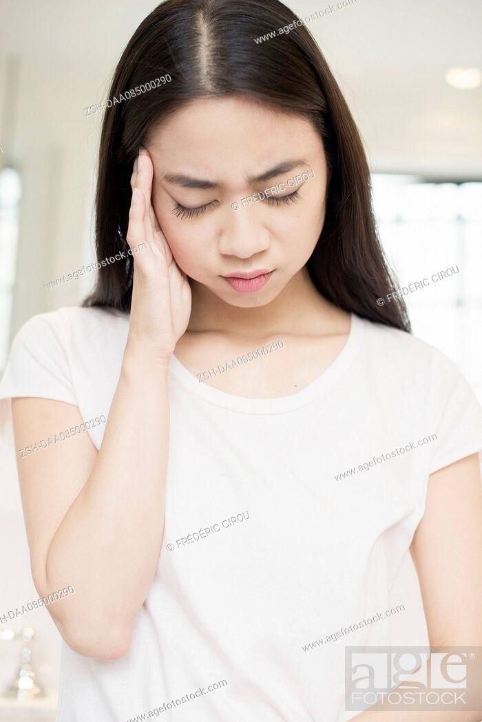 Stock Photo: Woman suffering a headache.