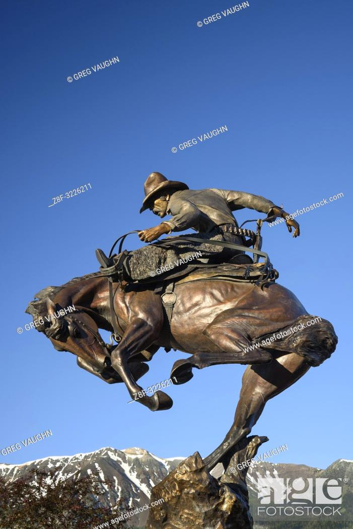 "Stock Photo: ""Attitude Adjustment"" bronze sculpture of cowboy and bucking bronco by Austin Barton in downtown Joseph, Oregon."