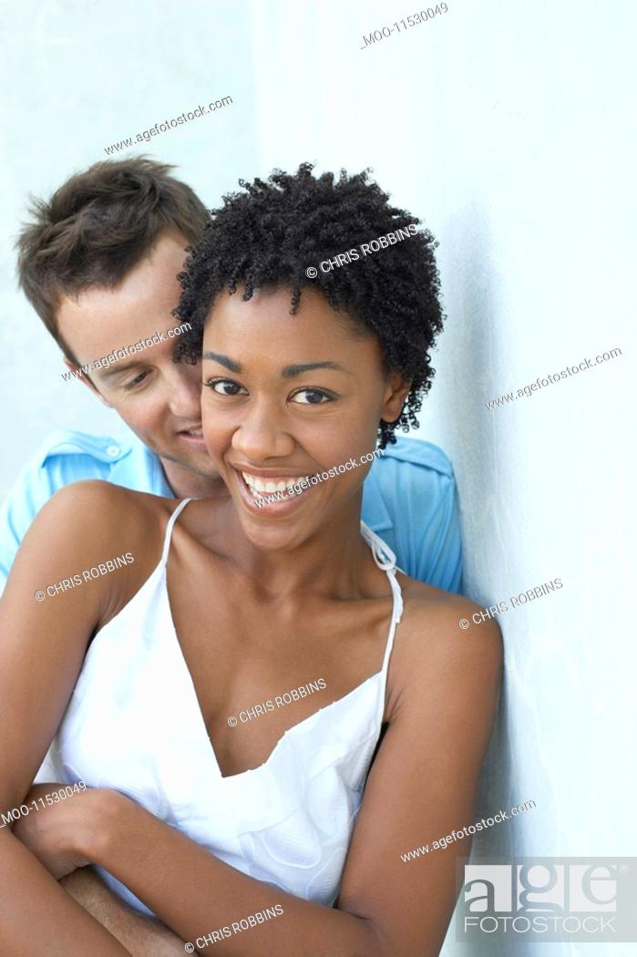 Stock Photo: Couple standing together against wall portrait.