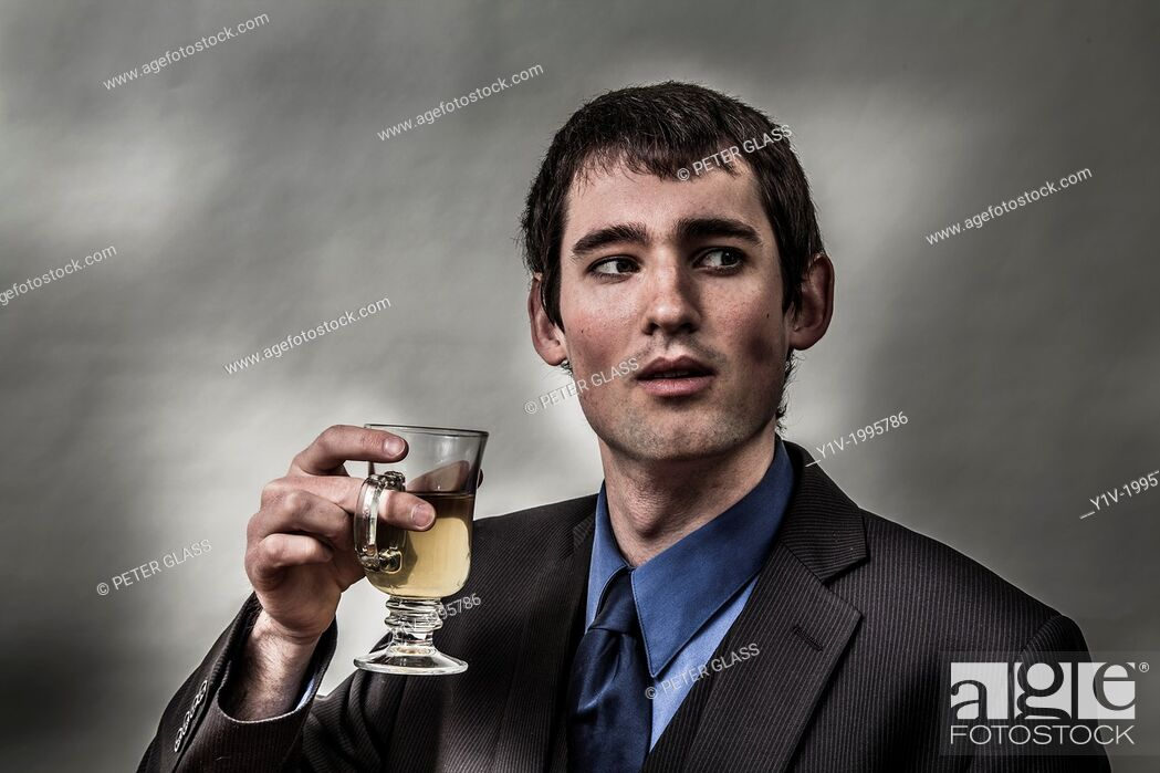 Stock Photo: Young man with a glass of tea.