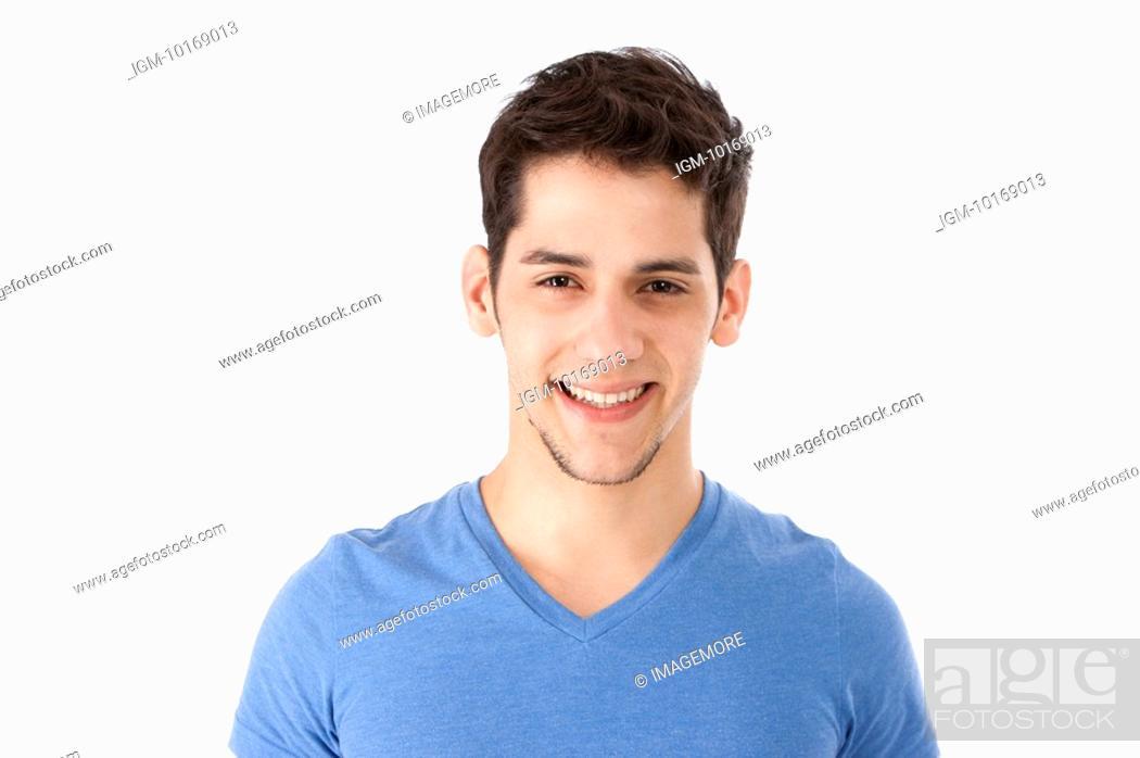 Stock Photo: Young man smiling at camera.