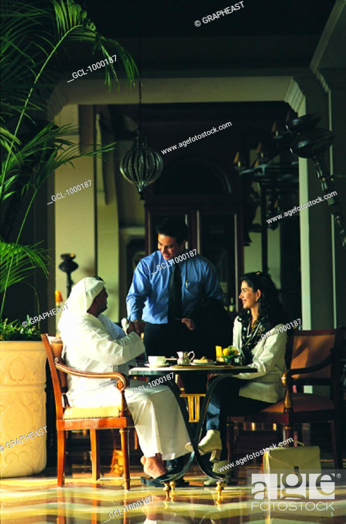 Stock Photo: Meeting of Arab businesspeople in a cafe.