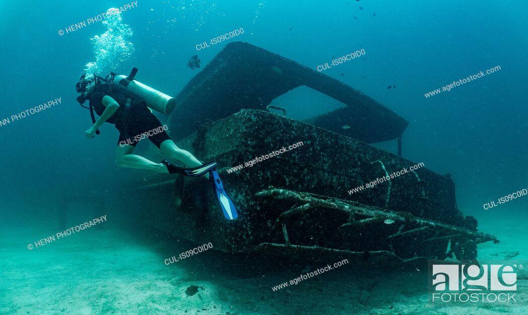 Stock Photo: Diver exploring wreck, Ko Racha Yai, Rawai, Phuket, Thailand.