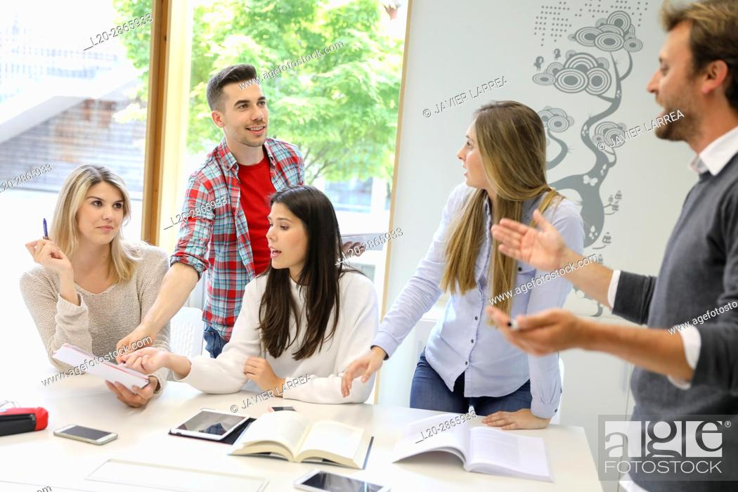 Stock Photo: Teacher with group of students doing a joint work, University of the Basque Country, San Sebastian, Donostia, Gipuzkoa, Spain.