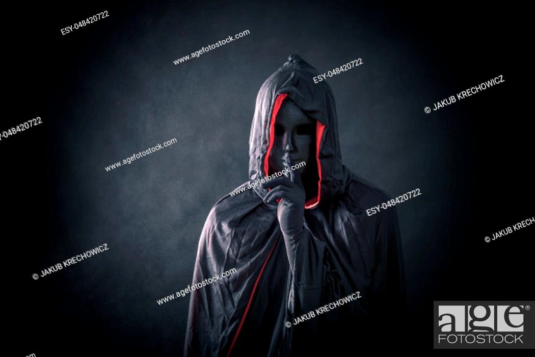 Stock Photo: Scary figure with black mask in hooded cloak.