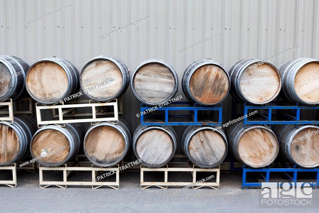 Stock Photo: Stacked wine barrels at a winery.