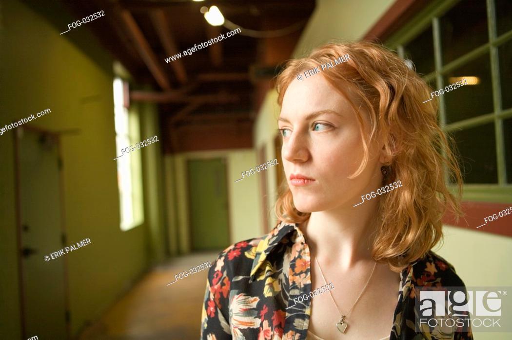 Stock Photo: Young Woman in Urban Corridor.