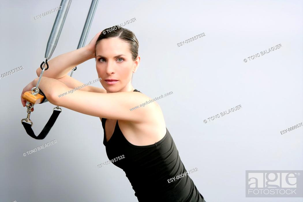 Stock Photo: Cadillac trapeze pilates woman portrait fitness sport beautiful girl.