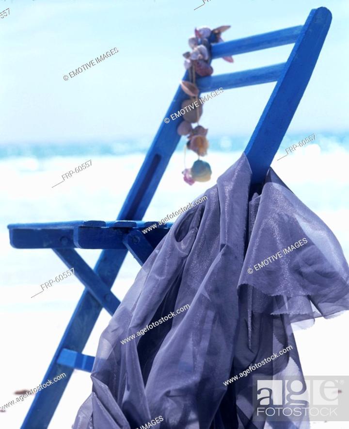 Stock Photo: On the beach: blue folding chair.