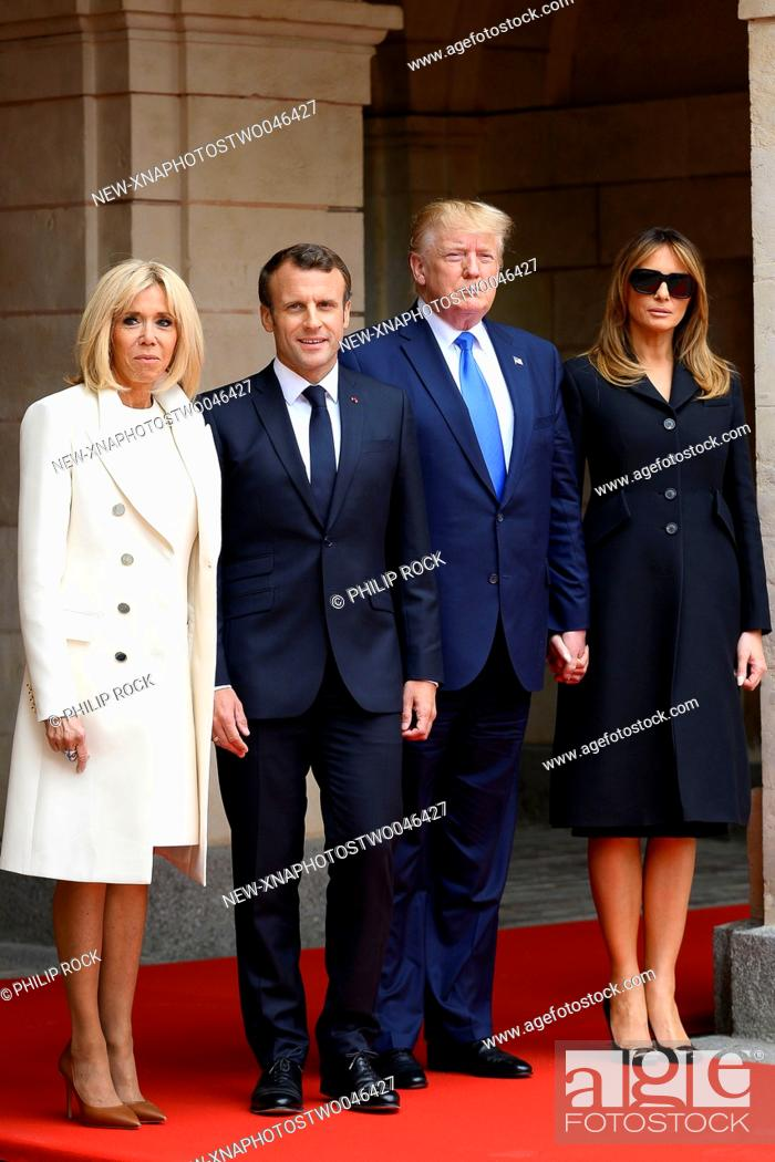 Stock Photo: (190606) -- CAEN, June 6, 2019 (Xinhua) -- French President Emmanuel Macron (2nd L) and his wife Brigitte Macron (1st L) meet with U.S.