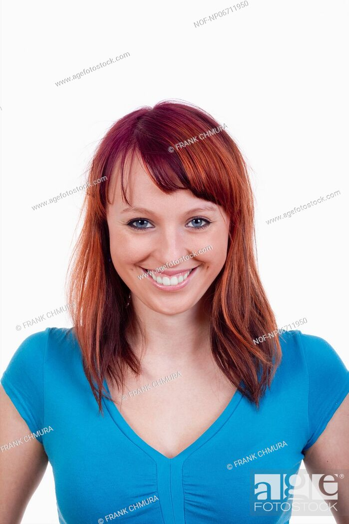 Stock Photo: portrait of a young woman with red hair - isolated on white.
