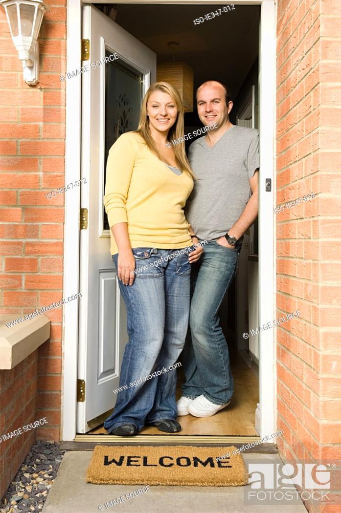 Stock Photo: Couple standing in doorway.