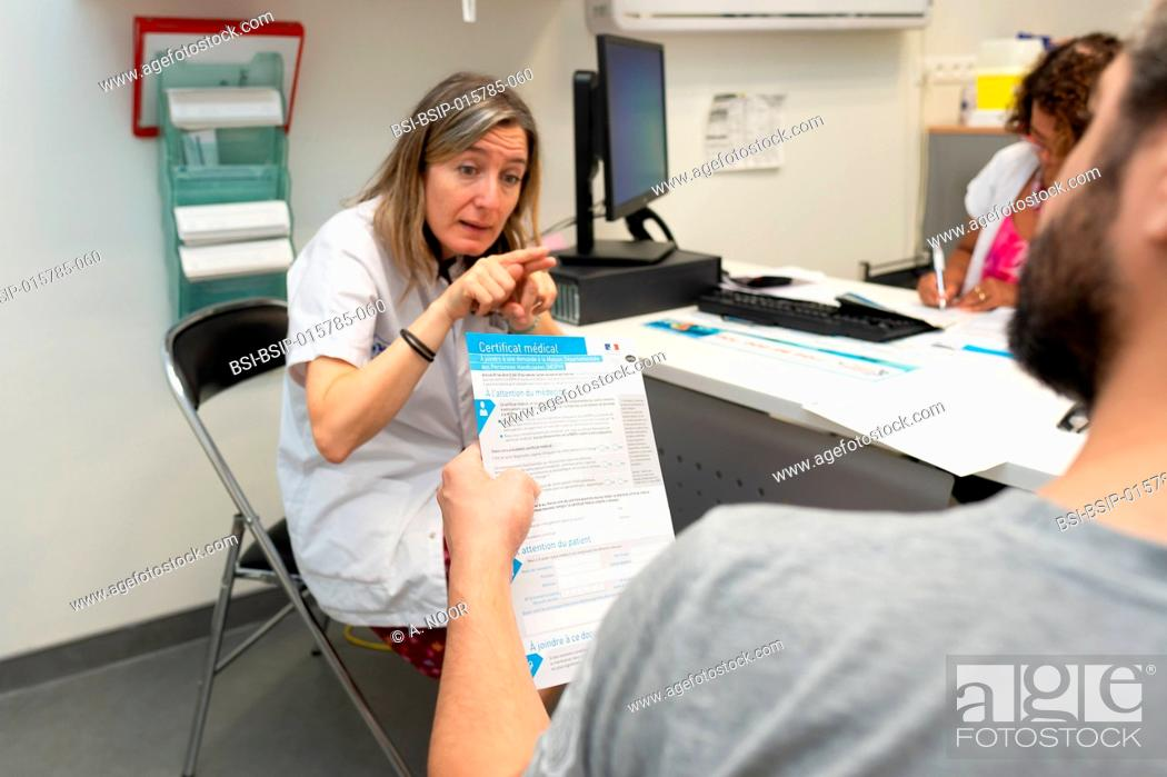 Stock Photo: Care for deaf patients in sign language, Nice Hospital, France. Consultation with a patient who is under 40 and deaf, suffering from Usher syndrome.