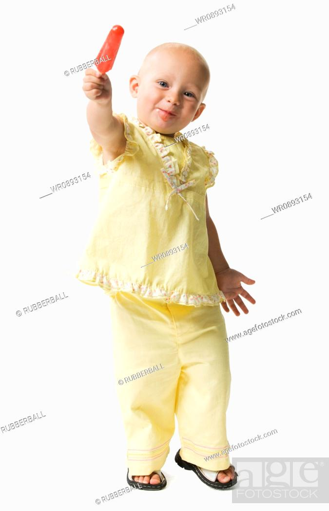 Stock Photo: Portrait of a girl holding an ice-cream and smiling.