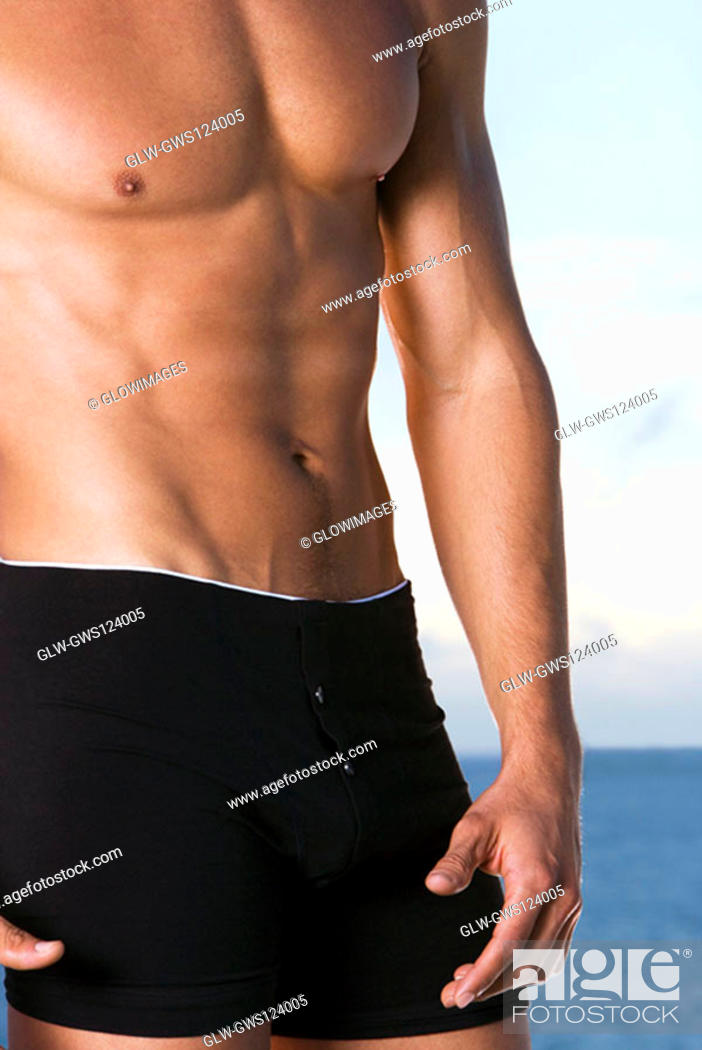 Stock Photo: Mid section view of a young man standing.
