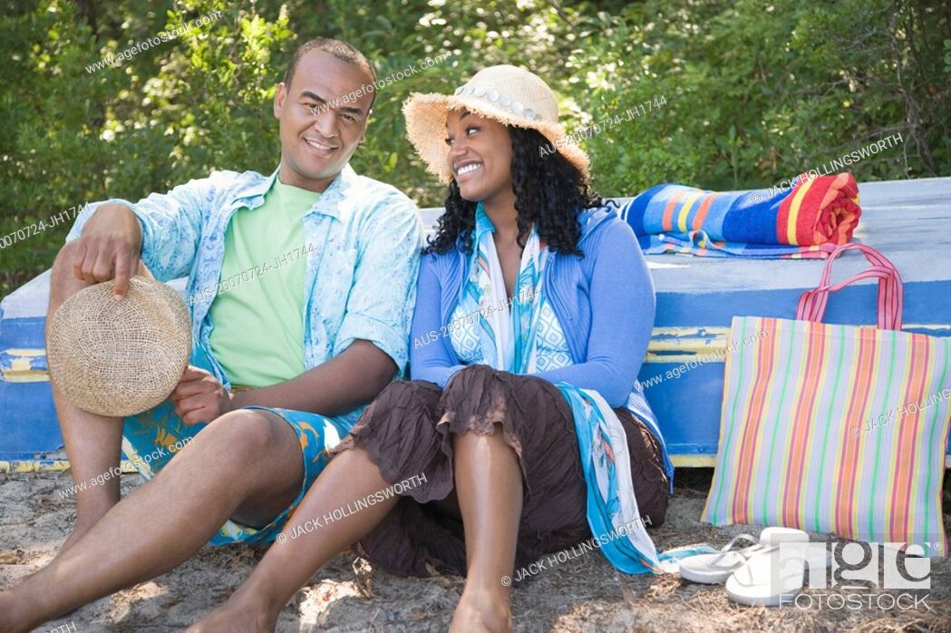 Stock Photo: Portrait of a mid adult man and a young woman sitting together.