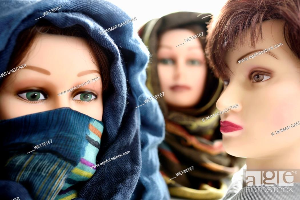 Stock Photo: Two mannequin heads in hijabs and one without.