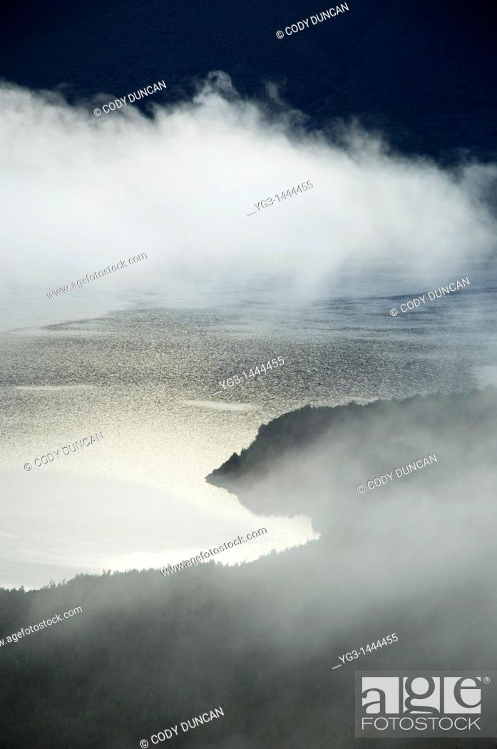 Stock Photo: Lake mist at dawn in Nelson Lakes national park, New Zealand.