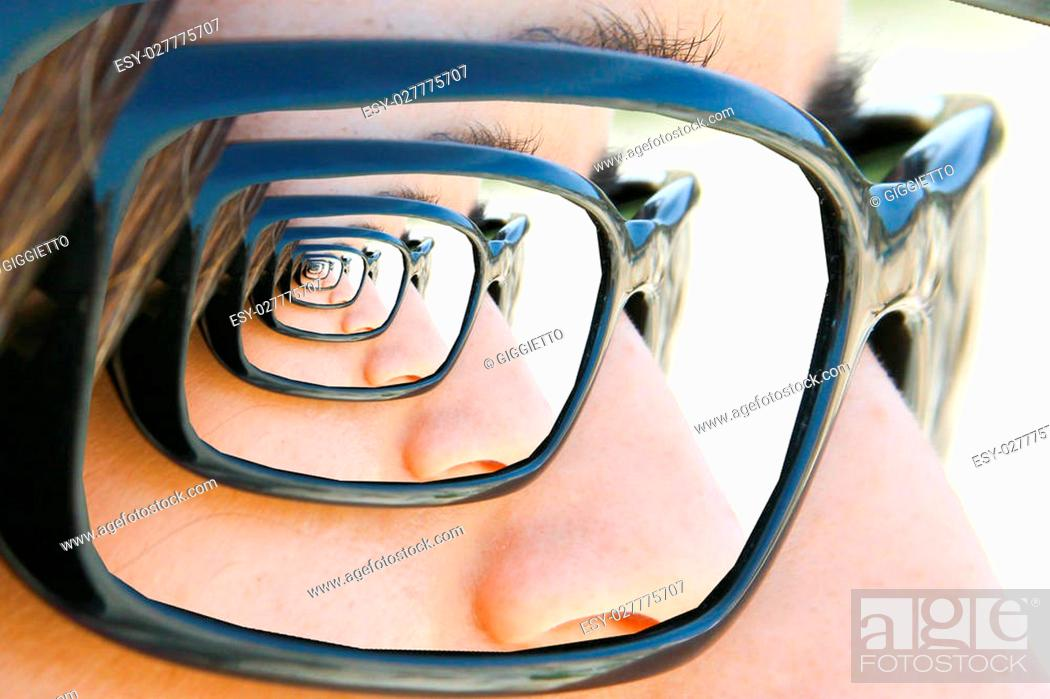 Stock Photo: Mirror sunglasses Droste. Look of a girl with sunglasses with droste effect.