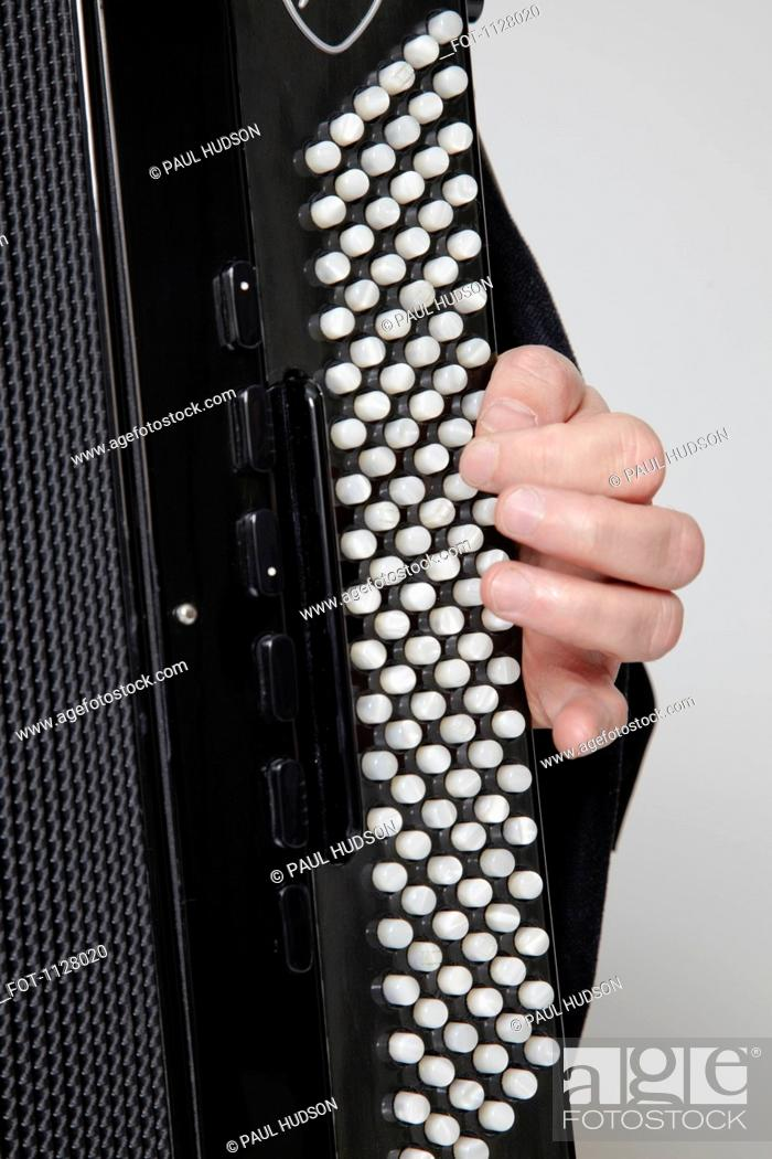 Stock Photo: Detail of a man playing an accordion.