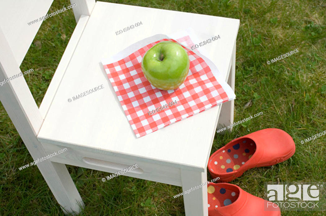 Stock Photo: Apple on a chair.