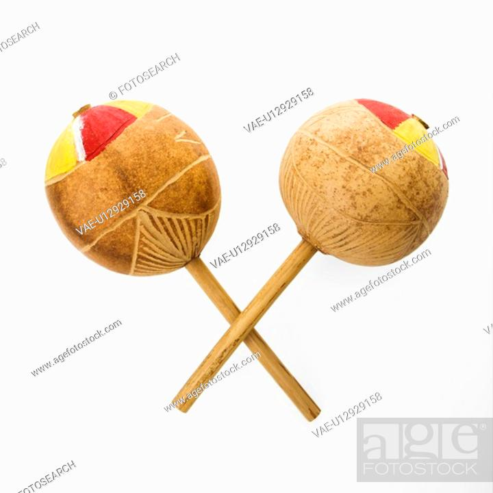 Stock Photo: Pair of handmade Mexican maracas percussion musical instruments against white background.