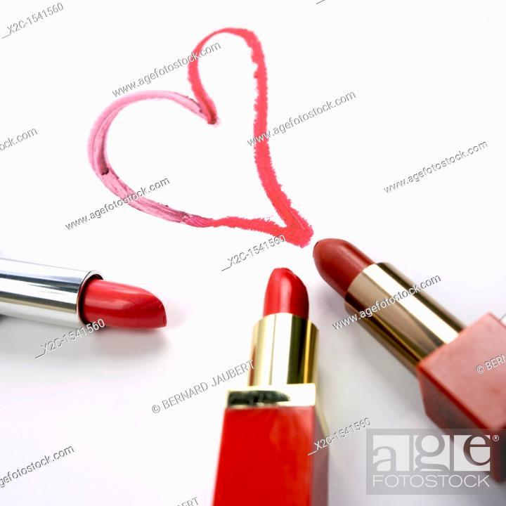 Stock Photo: Lipsticks, painted heart.