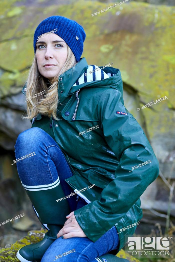 Stock Photo: Adult woman at the coast of Santa Clara Island, Donostia, San Sebastian, Gipuzkoa, Basque Country, Spain, Europe, Raincoat, Winter.