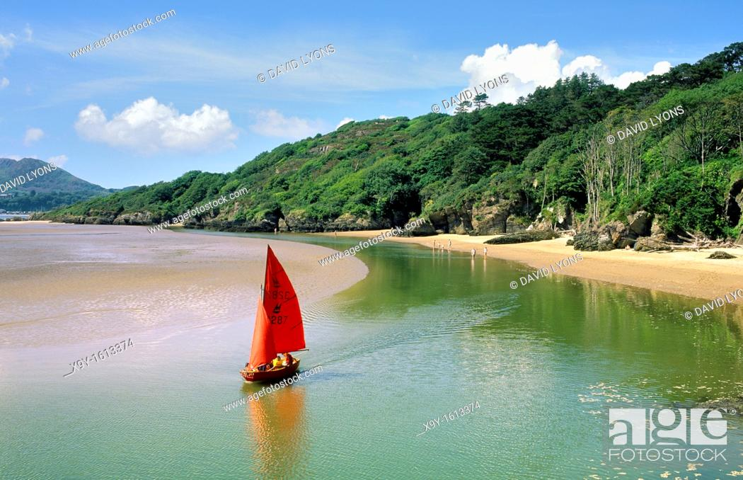 Stock Photo: Sailboat dinghy at White Sands Bay on the Portmeirion estate near Porthmadog, Gwynedd north Wales, UK  West across Tremadog Bay.