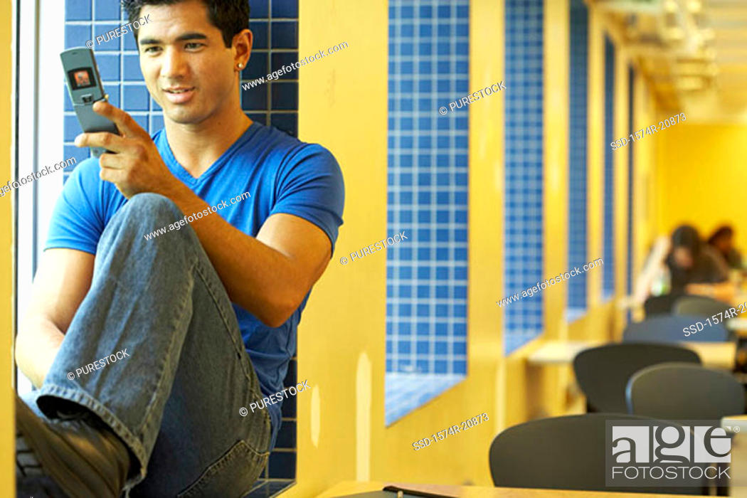 Stock Photo: Close-up of a college student using a mobile phone.
