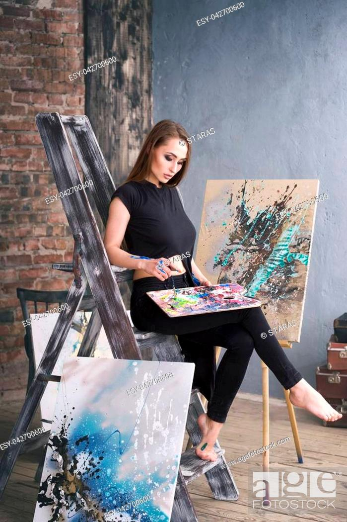 Photo de stock: Young female artist painting abstract picture in studio, beautiful sexy woman portrait.