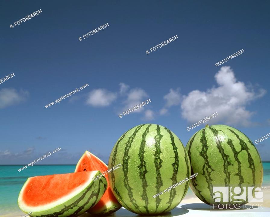 Stock Photo: Watermelon on a beach.