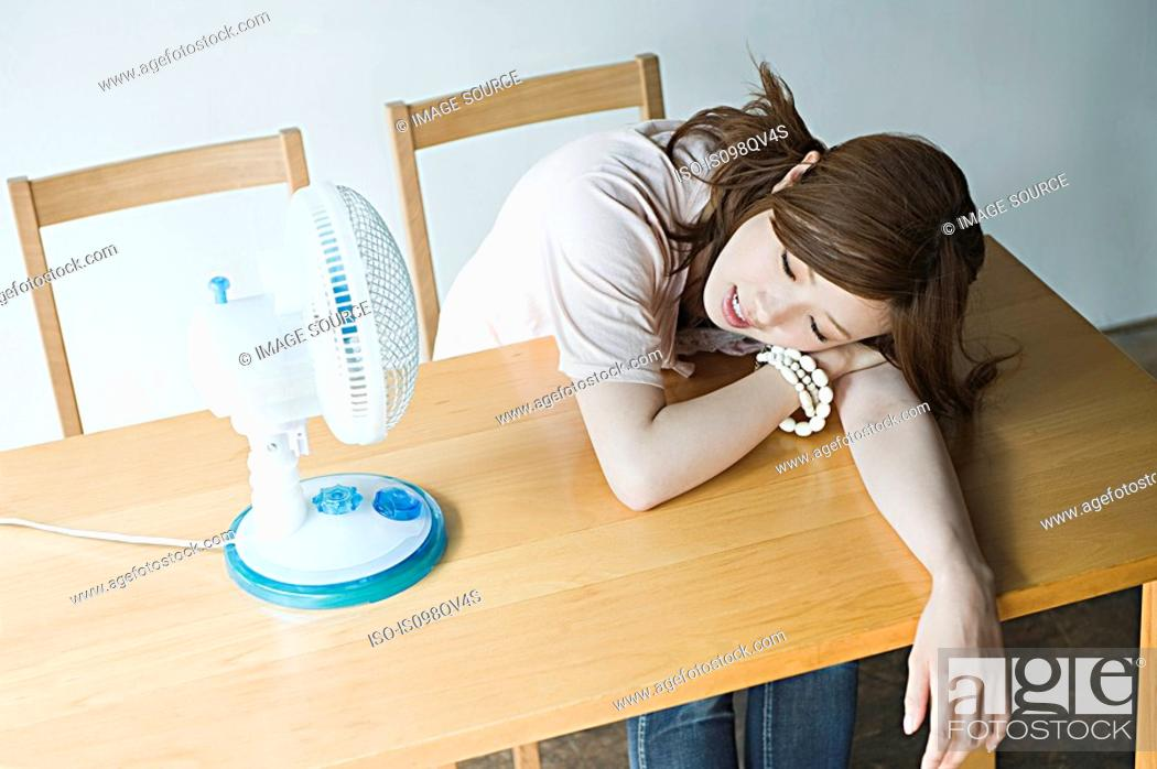 Stock Photo: Young woman with fan.