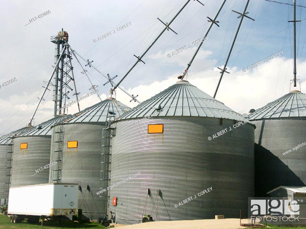 Stock Photo: Modern grain storage bins and distribution pipes.