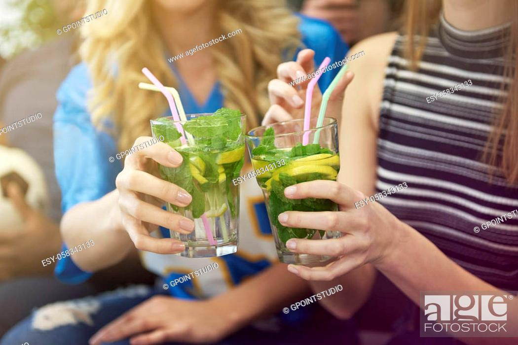 Stock Photo: Close up of girls with drinks.