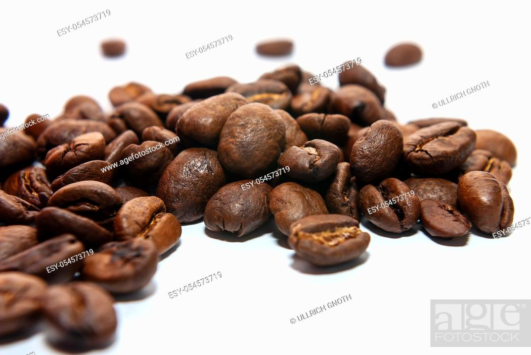 Stock Photo: Coffee beans on a white background.