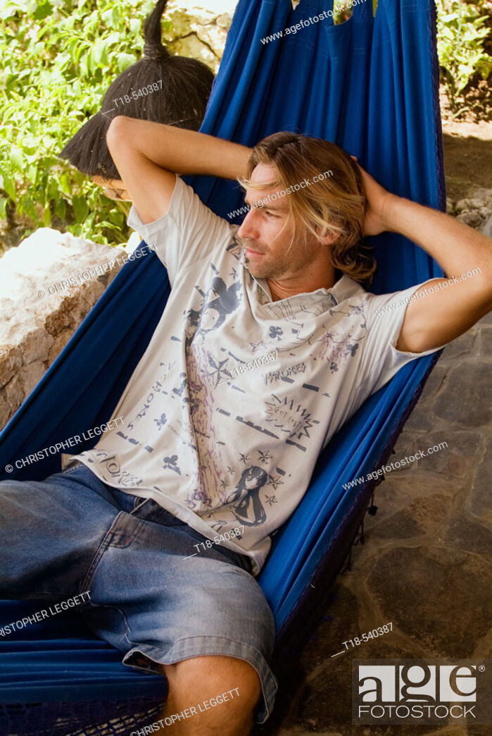 Stock Photo: young man relaxing on hammock.