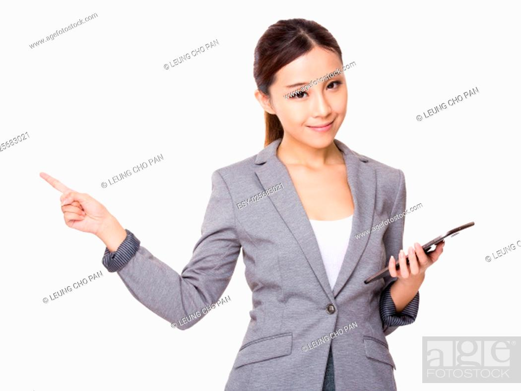Stock Photo: Asian businesswoman hold a tablet pc and finger point up.