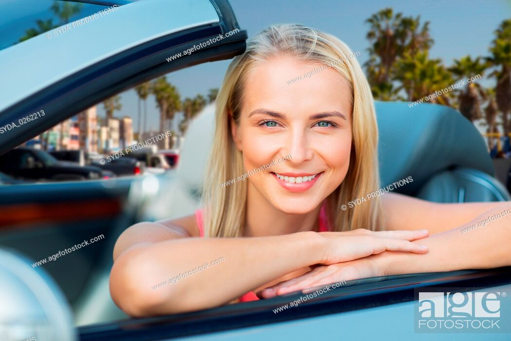 Stock Photo: woman in convertible car over venice beach.