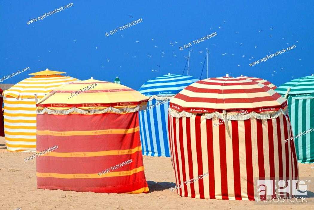 Stock Photo: Typical color striped beach cabins, beach and sea, Trouville sur Mer, 14, Normandy, France.