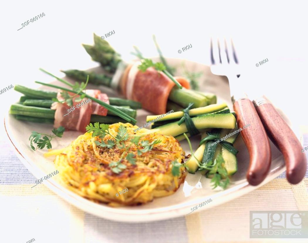 Stock Photo: Potato paillasson with bundles of green vegetables.