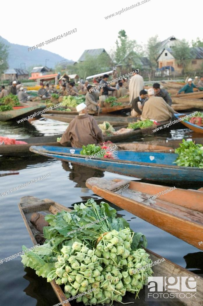 Stock Photo: Group of people selling vegetables in boats, Dal Lake, Srinagar, Jammu and Kashmir, India.
