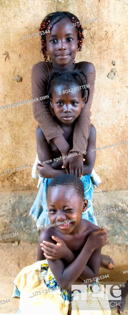 Stock Photo: Cute girls playing together in Ouagadougou, Burkina Faso.